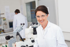 Scientists working with microscope and computer. In laboratory Royalty Free Stock Images