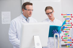 Scientists working together. In the laboratory Stock Photo