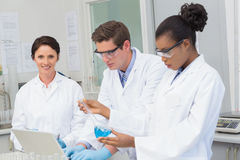 Scientists working together on precipitate tests Stock Photos