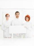Scienziati in laboratorio chemstry Immagini Stock Libere da Diritti