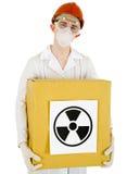 Scienziato con una casella radioattiva immagine stock
