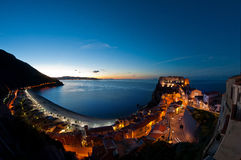 Scilla in the blue hour. The village of Scilla (Reggio Calabria) shooting long exposures in blue to the right Ruffo castle in the background the Strait of Royalty Free Stock Images
