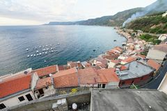 Scilla, Calabria. Beautiful aerial view of Chianalea cityscape a. Nd coastline at summer sunset royalty free stock photos