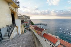 Scilla, Calabria. Beautiful aerial view of cityscape and coastline at summer sunset royalty free stock photo