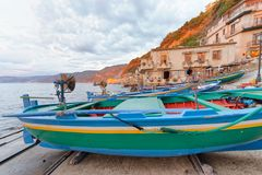 Scilla, Calabria. Docked boats in the city port at summer sunset. Italy stock photo