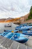 Scilla, Calabria. Docked boats in the city port at summer sunset. Italy royalty free stock images