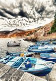Scilla, Calabria. Docked boats in the city port at summer sunset. Italy royalty free stock photo