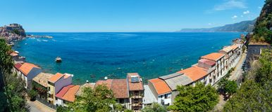 Scilla sea coast, Calabria, Italy. Summer Tyrrhenian Sea coast and beautiful Scilla town view, Calabria, Italy. Three shots stitch panorama royalty free stock images