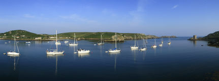 Scillies, Cornwall England. Channel with yachts between Tresco and Bhryer stock photo