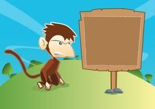 Scimmia con Signboad di legno vuoto Fotografie Stock Libere da Diritti
