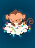Scimmia e ghirlande sveglie del bambino Scimmia del bambino da vendere Scimmia di sonno Bambola della scimmia del bambino Fotografia Stock Libera da Diritti