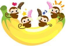 Scimmie graziose - mangiando le banane del cioccolato insieme Fotografie Stock Libere da Diritti