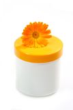 Scin Care. Cream pot with marigold on white background Stock Photos