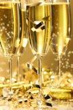Scintilla dorata del champagne Immagine Stock
