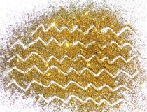 Scintilla dorata di scintillio su fondo bianco Immagine Stock