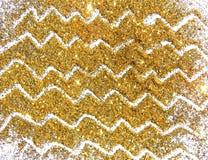 Scintilla dorata di scintillio su fondo bianco Immagine Stock Libera da Diritti