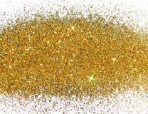Scintilla dorata di scintillio su fondo bianco Fotografia Stock