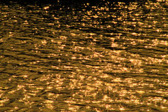 Scintillate sunlight, in the river. Background Royalty Free Stock Photography