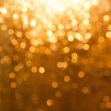 Scintille dorate, fondo astratto Fotografie Stock