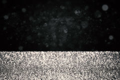 Scintillement argenté sur le fond noir Photos libres de droits