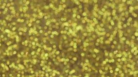 Scintillement d'or en baisse magique avec les étoiles bleues minuscules, mouvement lent clips vidéos