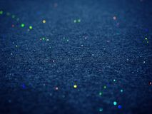 Scintillement de Bokeh sur la texture bleu-foncé de tissu de coton photo stock