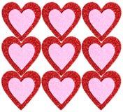 Scintillement rouge et coeurs roses d'isolement. Fond Photo stock