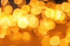 Scintillio dell'oro con effetto del bokeh immagine stock