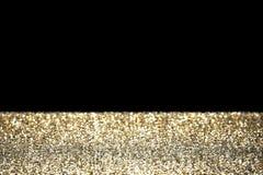 Scintillio dell'oro con fondo nero Fotografia Stock