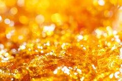 Scintillio dell'oro della caramella Fotografia Stock