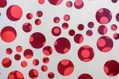 Scintillio rosso su fondo bianco Fotografie Stock Libere da Diritti