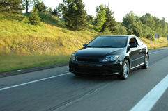 Scion tC driving on the Highway Stock Photo