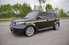 Scion xb in motion. A modified sport compact vehicle caught in motion while speeding. See my portfolio for more automotive images stock images