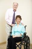 Sócios comerciais - cadeira de rodas Fotografia de Stock Royalty Free