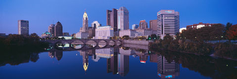 Scioto River and Columbus Ohio skyline, the capital city, at dusk with lights on Stock Photo