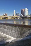 Scioto River with waterfall and Columbus Ohio skyline, with setting sunlight Stock Photography