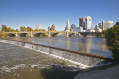 Scioto River with waterfall and Columbus Ohio skyline, with setting sunlight Royalty Free Stock Photos