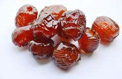 Sciroppo cinese del rivestimento della caramella della giuggiola su fondo bianco fotografie stock libere da diritti
