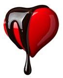 Sciroppo di cioccolato che cola sulla figura del cuore Fotografia Stock