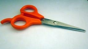 Scissor auf weißem Hintergrund Stockfotografie
