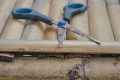 Scissor on bamboo table Royalty Free Stock Photography