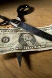 Scissor Cutting Dollar Bill Royalty Free Stock Images