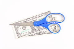 Scissor on Dollar Bills Royalty Free Stock Photography