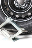 Scissor Jack Or Car Lifter And Tire Royalty Free Stock Photography