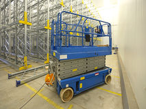 Scissor lift. Aerial work platform in warehouse Stock Images