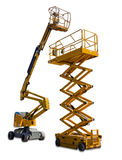 Scissor lift and articulated boom lift. Two types of mobile aerial work platform - yellow scissor hydraulic lift and yellow hydraulic articulated boom lift on Stock Photography