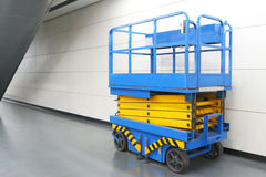Scissor Lift. At Indoor Place Royalty Free Stock Image