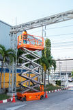 Scissor lift platform and electrical technician operated wiring. Royalty Free Stock Image