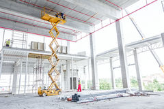 Free Scissor Lift Platform On A Construction Site Royalty Free Stock Images - 79363919