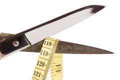 Scissor and measuring tape Stock Photos